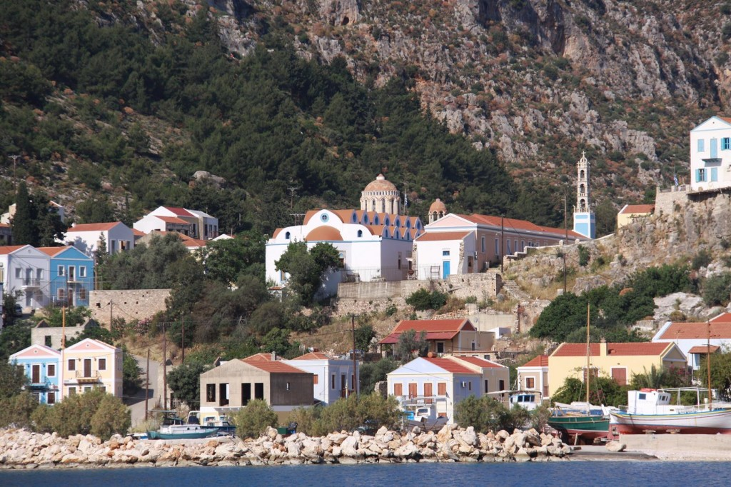 The old Church and Houses of Mandraki Bay