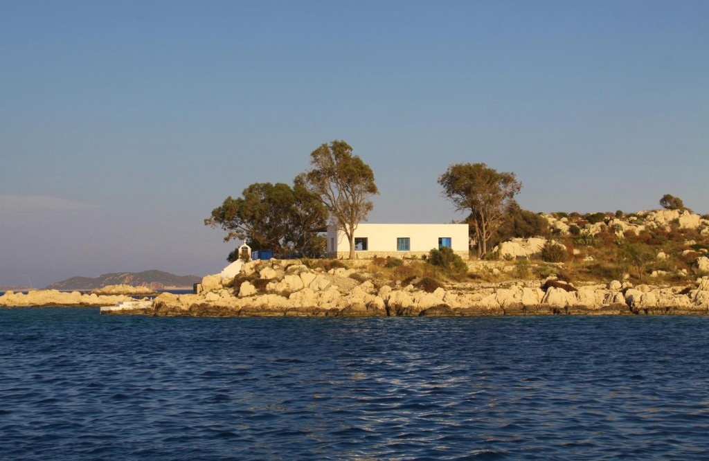 Small Island by Mandraki Bay with Typical Greek House