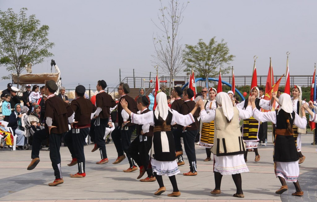 Traditional Dancers Perform In Front of the Large Crowd