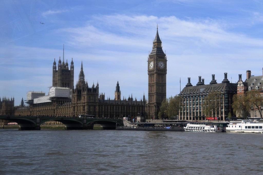 Big Ben overlooks the Thames and the Houses of Parliament at Westminster Hall
