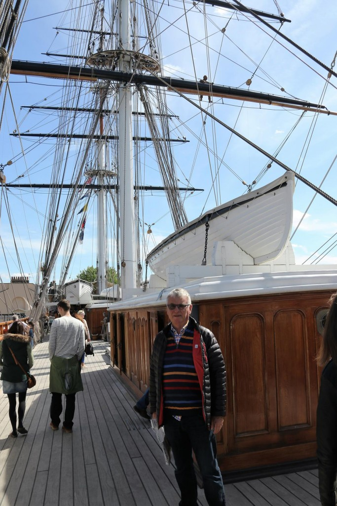 Many visitors climb aboard the Cutty Sark to look over the well restored vessel