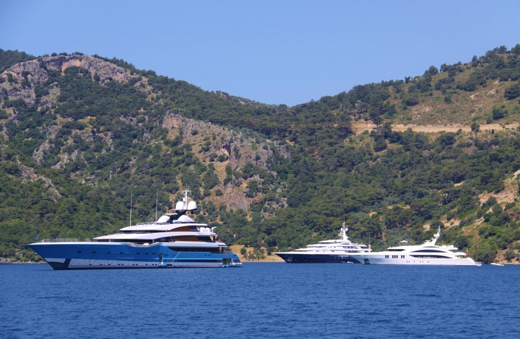 A Cluster of  Large Motor Yachts Almost Take Up a Whole Bay