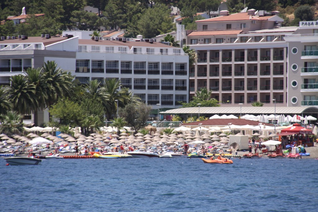 Wall to Wall Sun Lounges and Umbrellas Line the Shores as Far as the Eye can See
