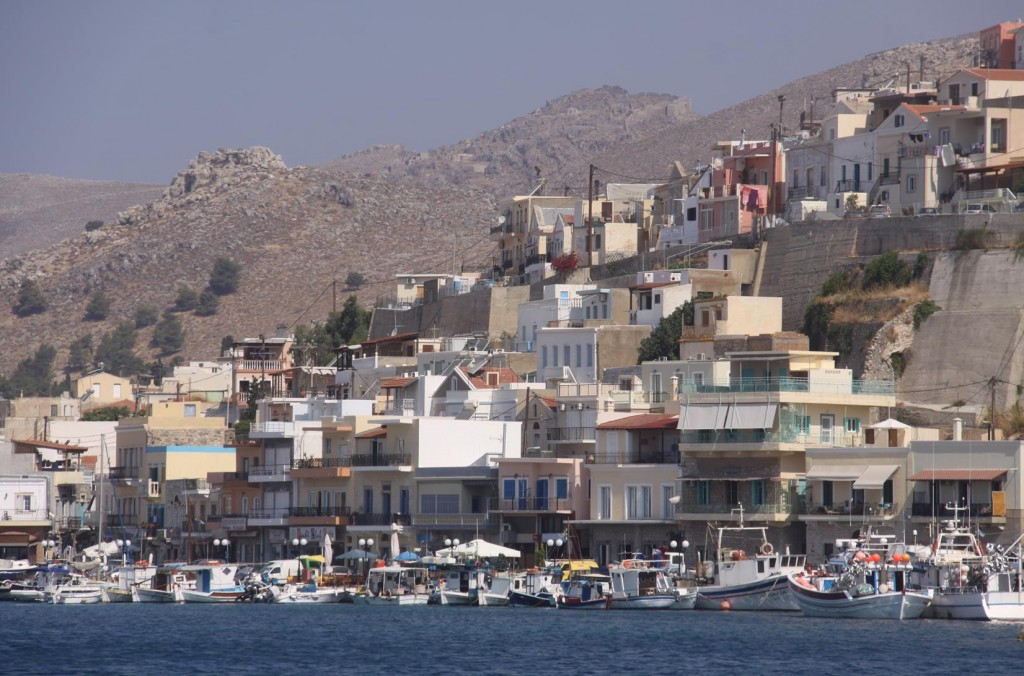 Clusters of Traditional Greek Houses Line the Shores of the Port