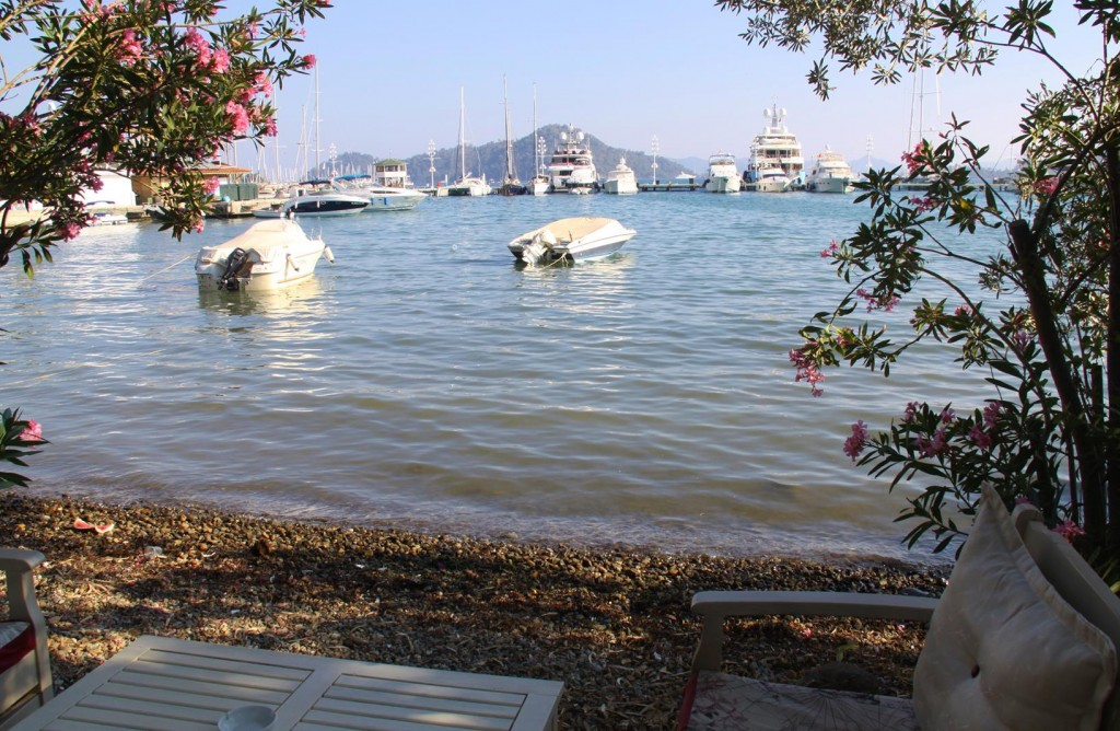 We Ride Along the Foreshore and Look Back at the Skopea Marina