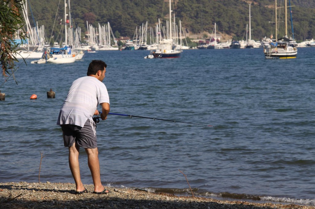 Locals Try Their Luck on the Water's Edge