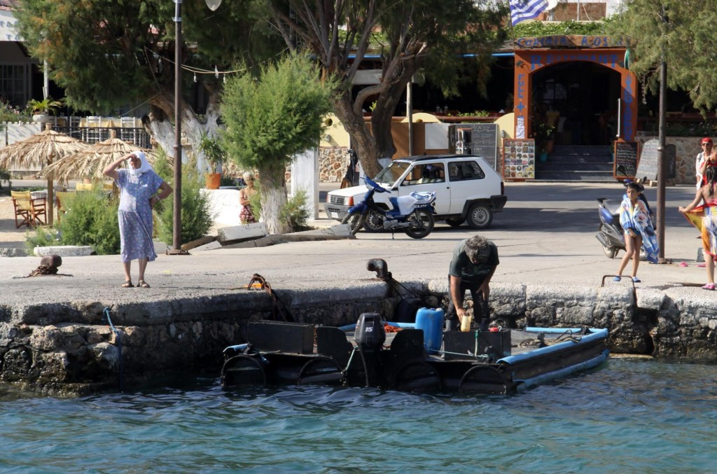 One of the Locals with His Plastic Pontoon Boat