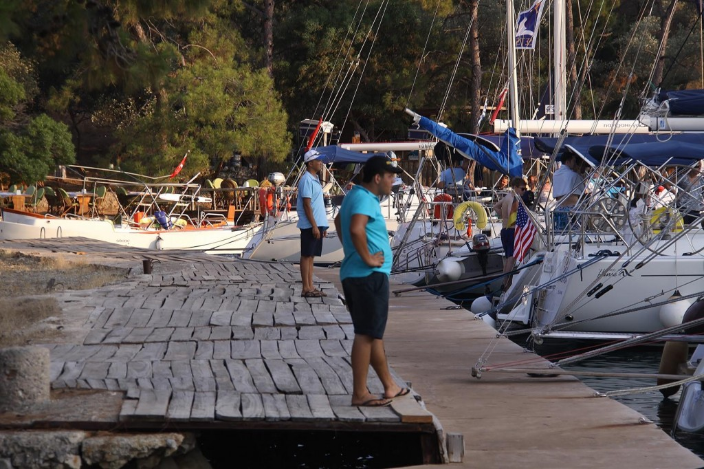 The Staff from the Restaurant Assist with the Mooring Lines of their Guests