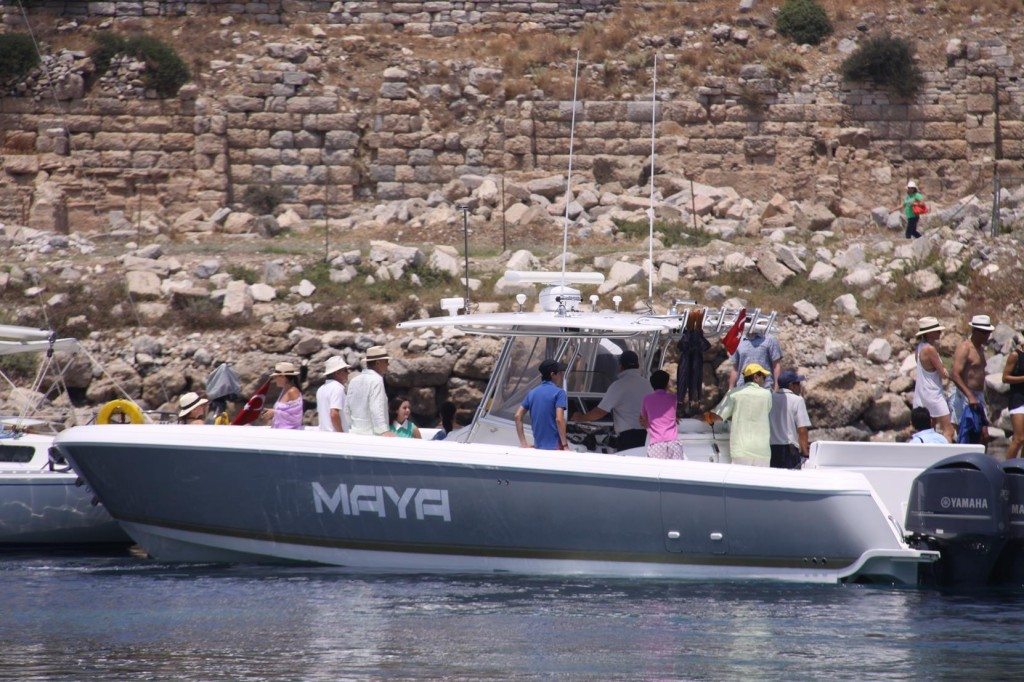 Some Guests from a  SuperYacht Arrive to Visit the Ancient Site
