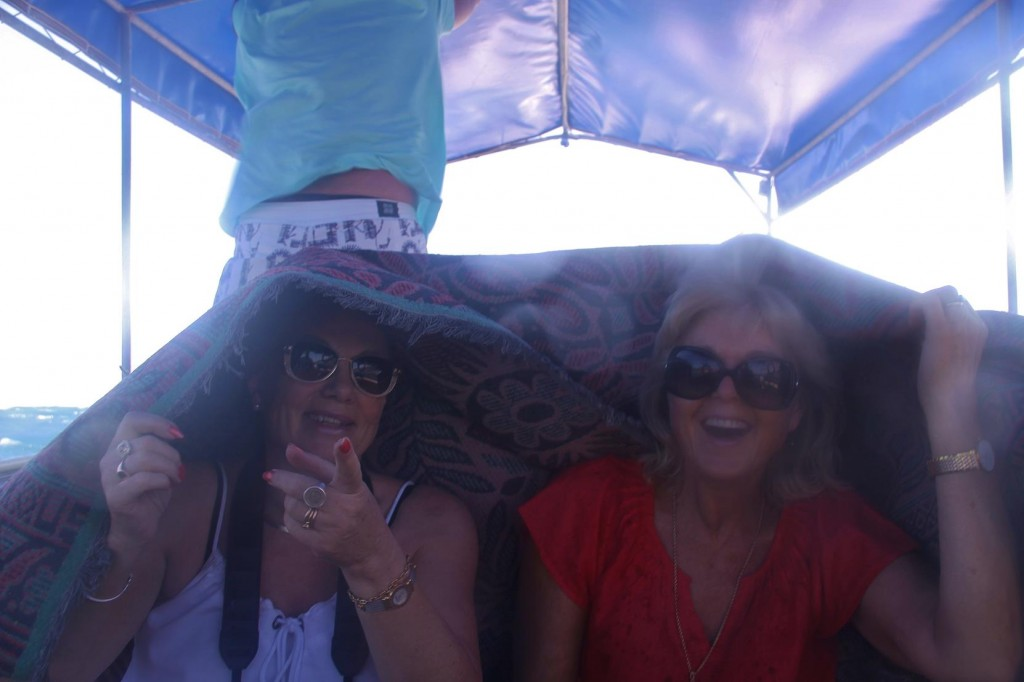 Kate and I Covered Ourselves with the Boat Carpet to Keep Dry