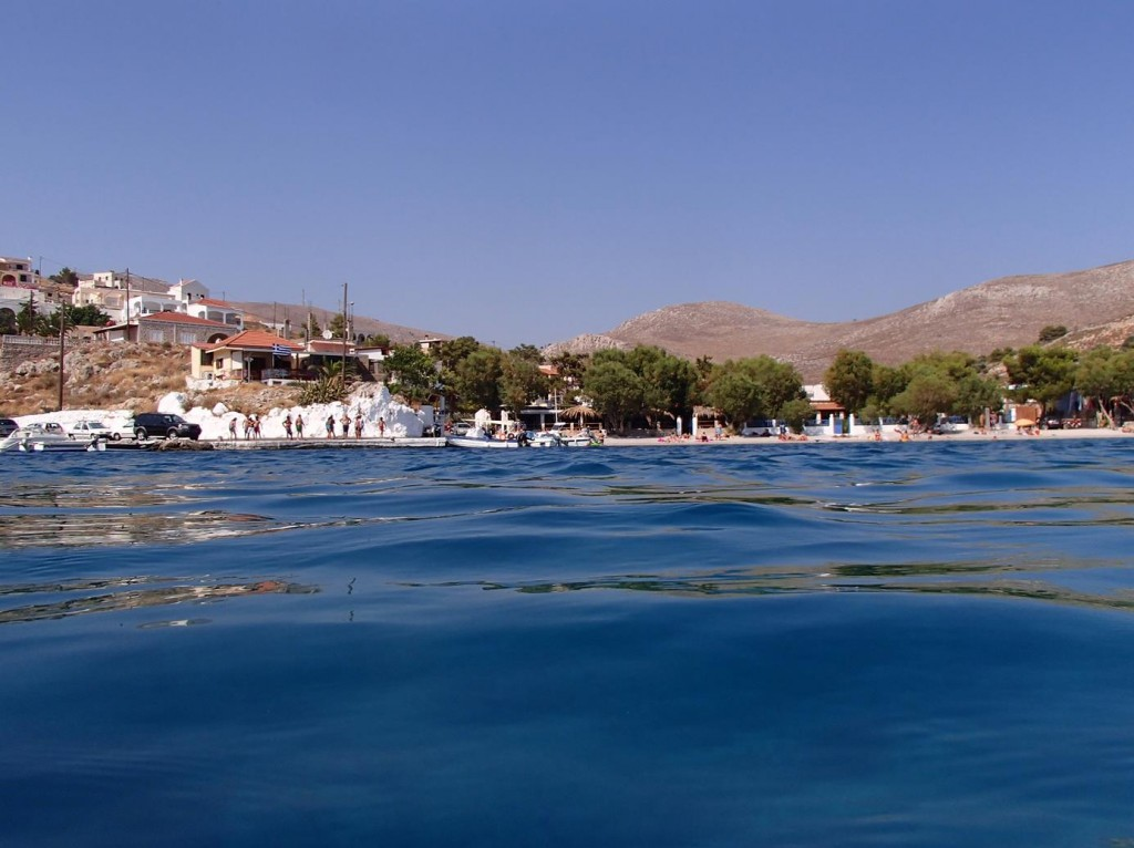 Many of the Locals and Visitors Enjoyed Swimmng in the Clear Waters of the Tiny Port