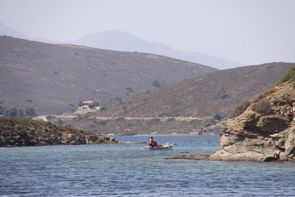 A Fisherman Appears and Disappears Between the Small Islands