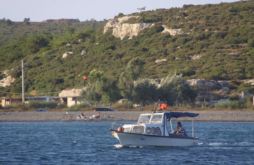 There are Still Boats Out and People on the Beach in the Evening Enjoying the Hot Weather