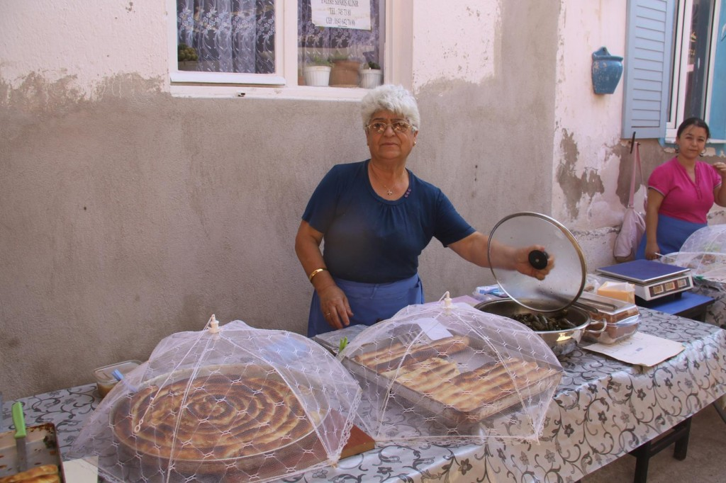 Another Proud Lady with her Tasty Spinach and Cheese Rolls and Turkish Dolamades