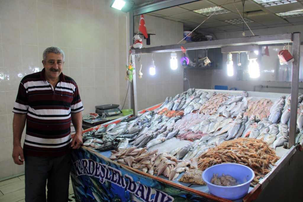 Our Proud Fishmonger with his Super Fresh Fish