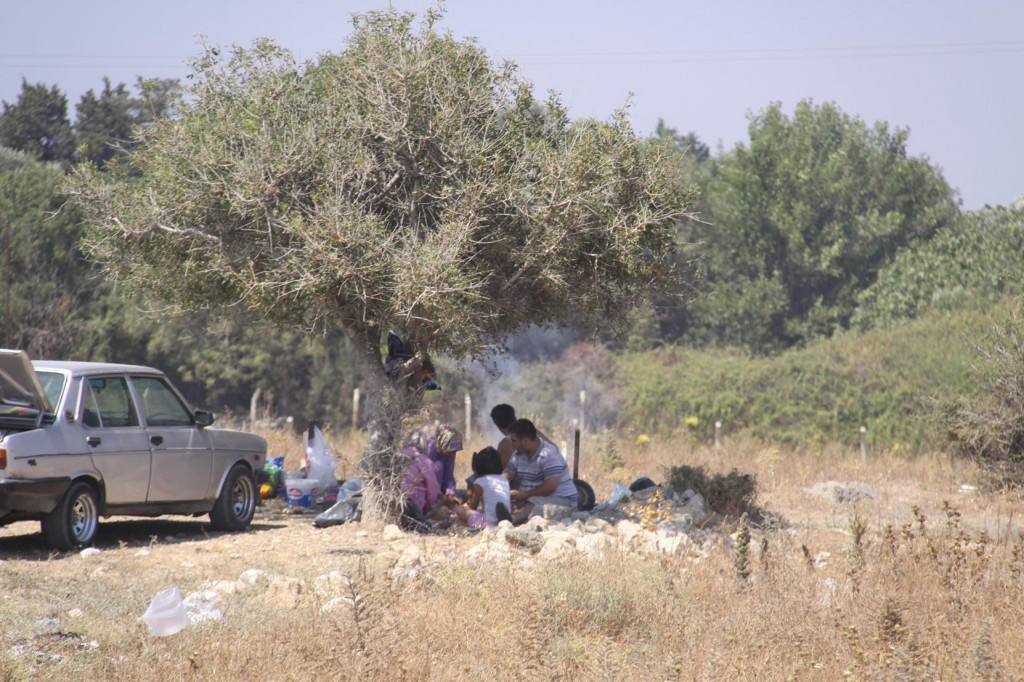 Some of the Locals Prepare Lunch Under the Trees