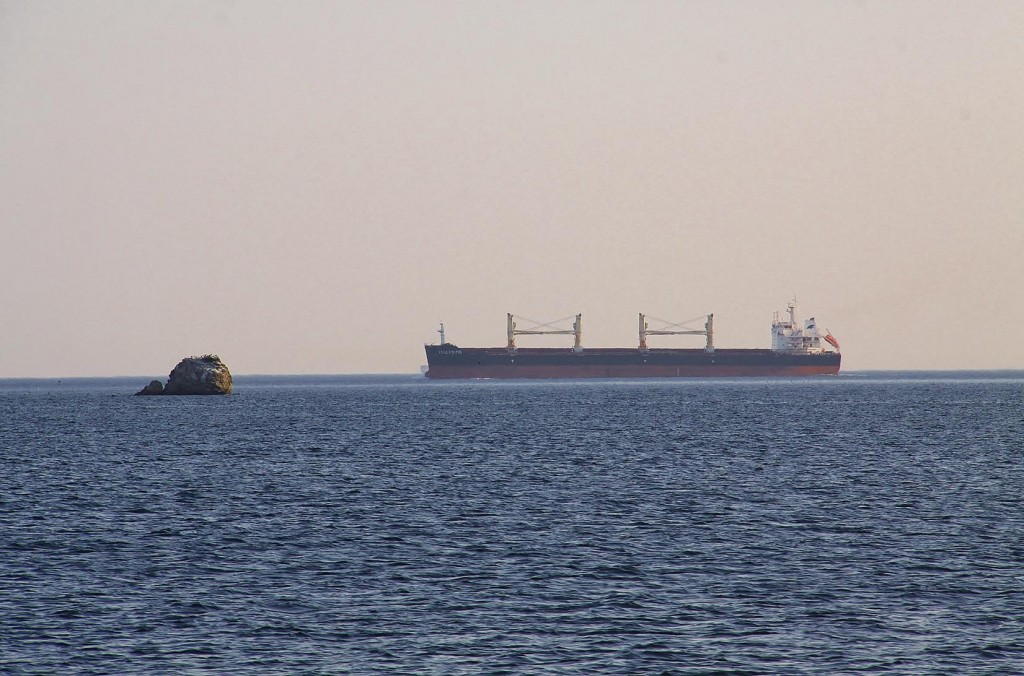 In the Distant the Only Vessel in the Area is a Freighter Passing By