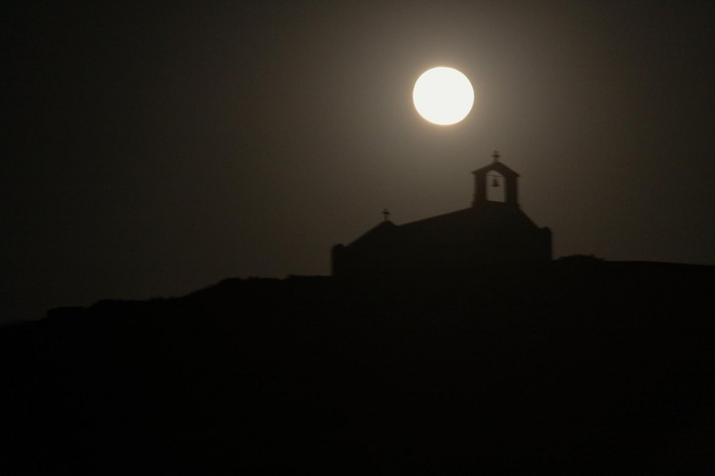 A Full Moon Rises Above the Church on the Hill