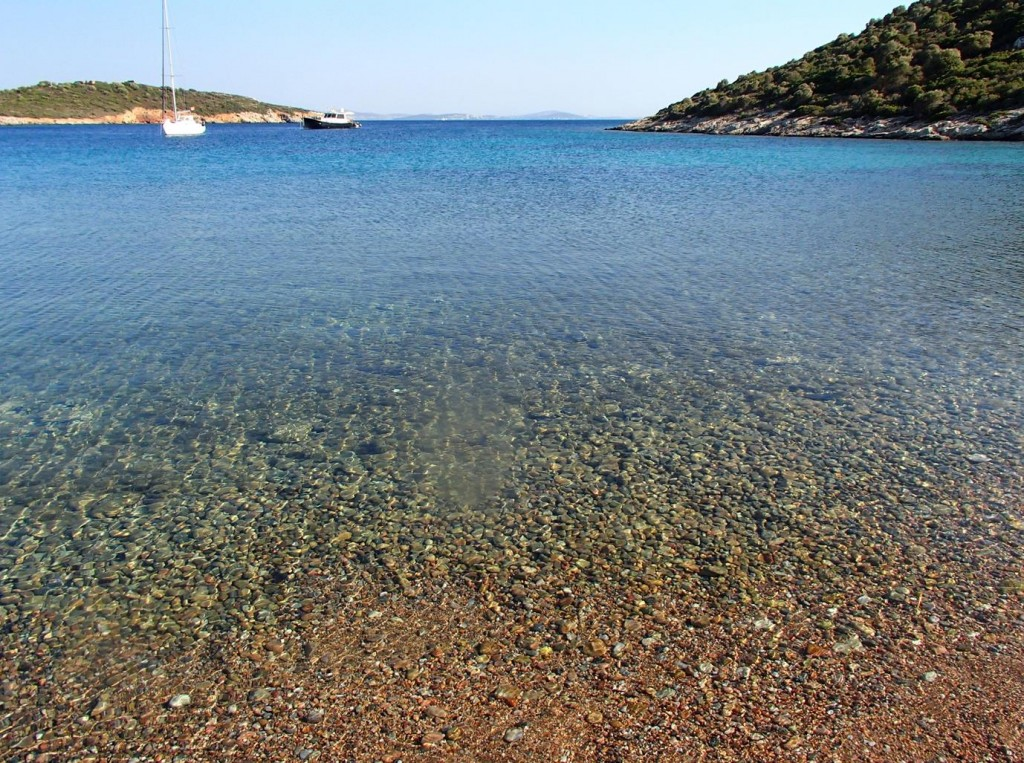 The Beach is Made Up of Colouful Small Pebbles and Sand