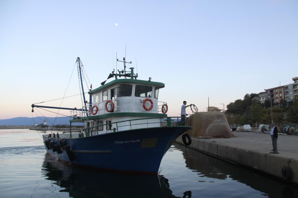 Another Fishing Boat Pulls into One of the Many Piers in the Harbour