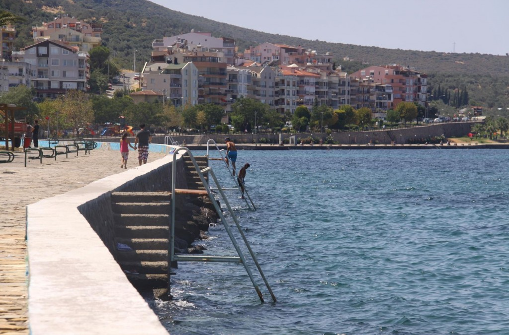 Both Locals and Visitors in Dikili Enjoy Swimming in the Sea from the Town's Seawall