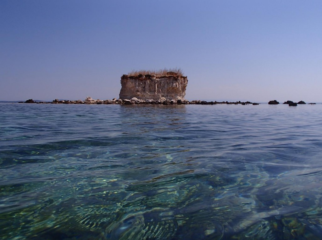 This Tiny Cake Shaped Islet was Surrounded by Shallow Warm Water and an Amazing Number of Small Fish