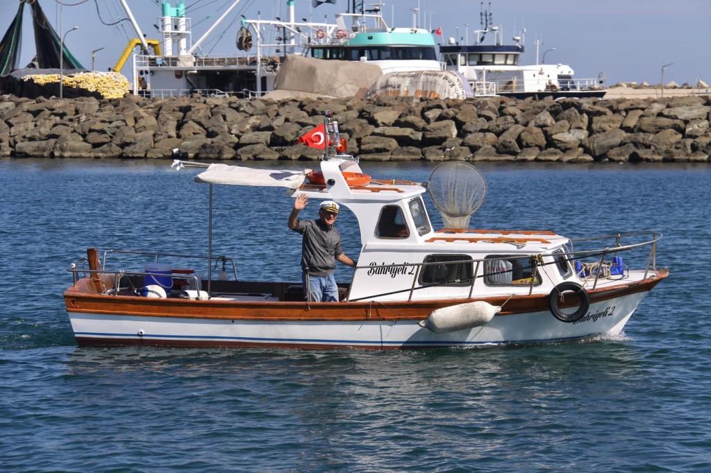 A Friendly Local Farwells Us as we Depart the Poyraz Port