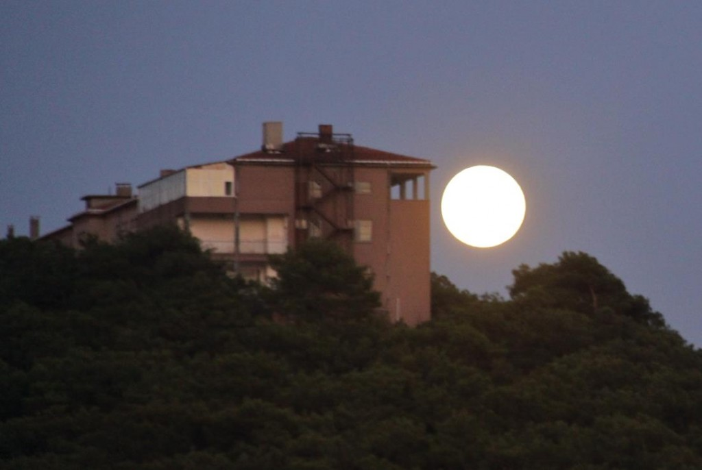 An Amazing Full Moon Appears Over the Hill