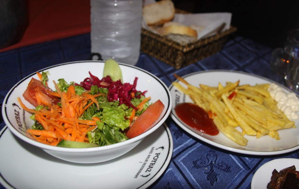Simple Fresh Salad and French Fries Served with the Fish