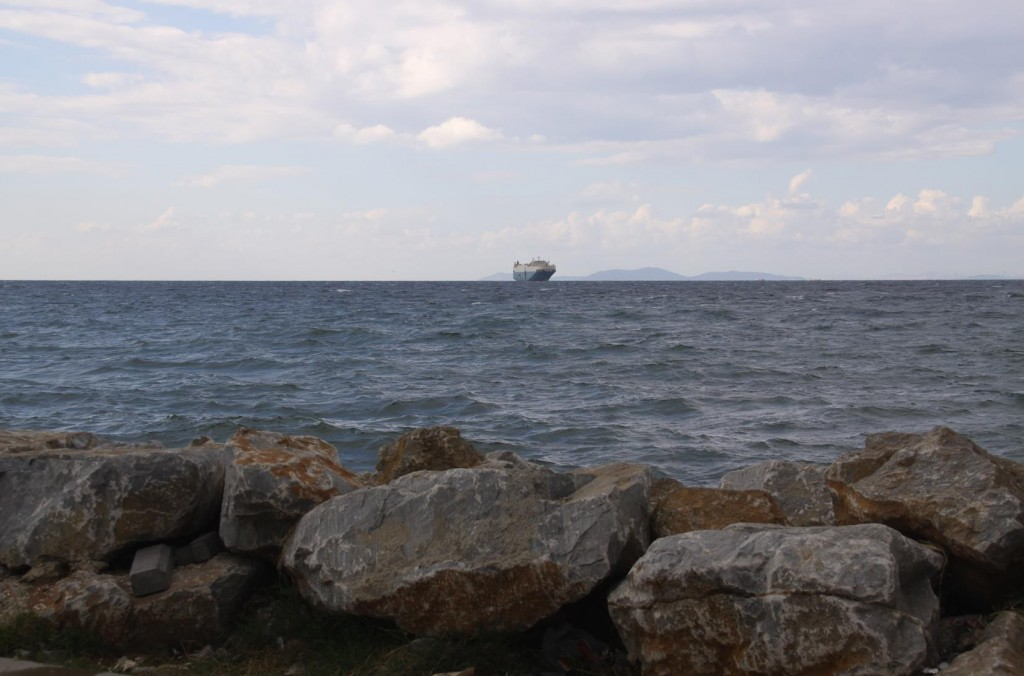 A Freighter in the Distance Heading for a Nearby Port