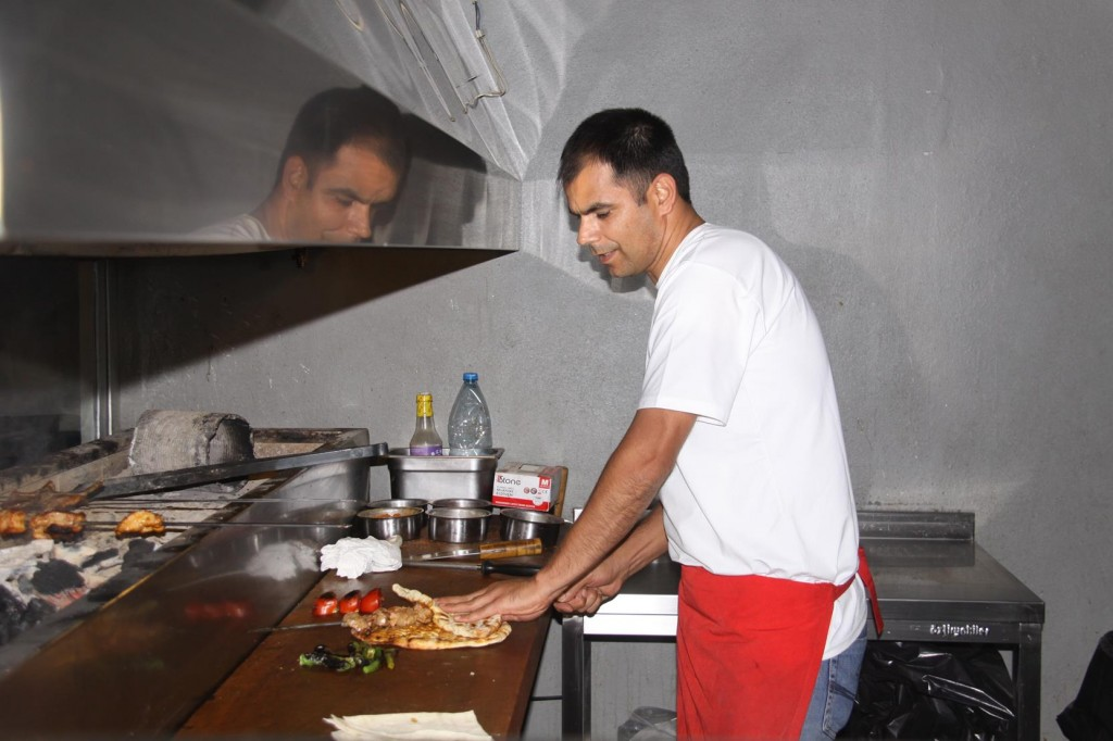 A Young Turkish Chef Preparing and Grilling some of the Delicious  Meat Skewers