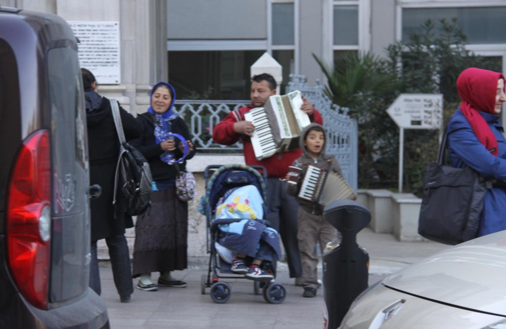 On Route we Pass a Family Busking in a Nearby Street