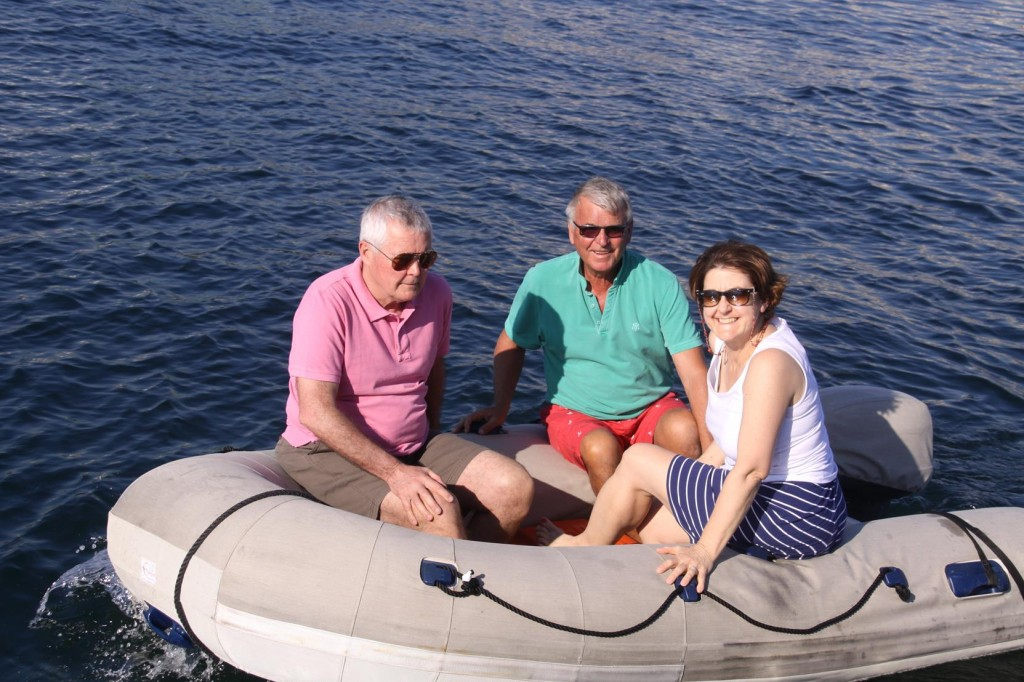 While I look after the Tangaroa, Ric takes Nick and Lois by Dinghy to View the Boats