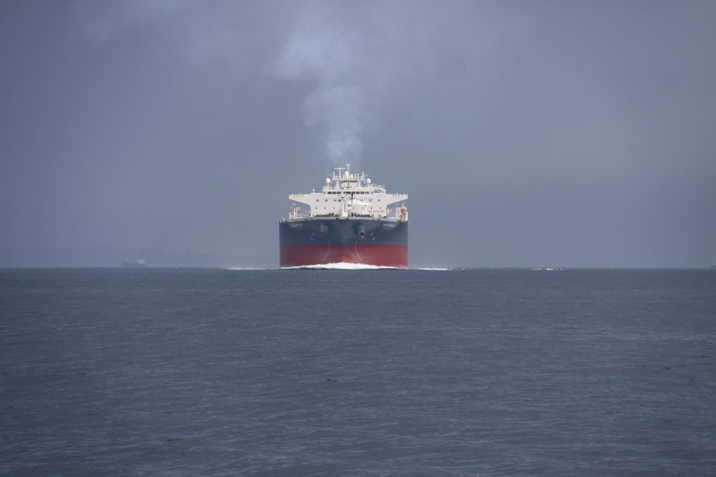 Through the Clouds a Large Ship Approaches at our Stern