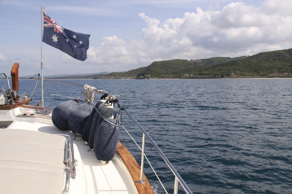 John Erects Our Australian Flag on the Boat Hook on the Bow of the Tangaroa