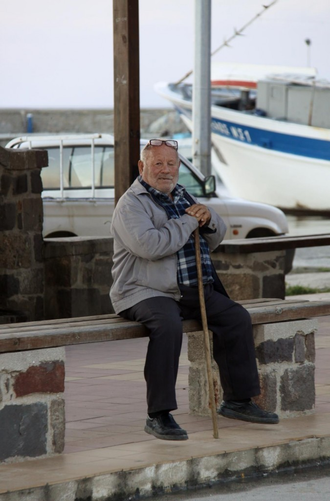 A Local Gentleman taking a Rest by the Port