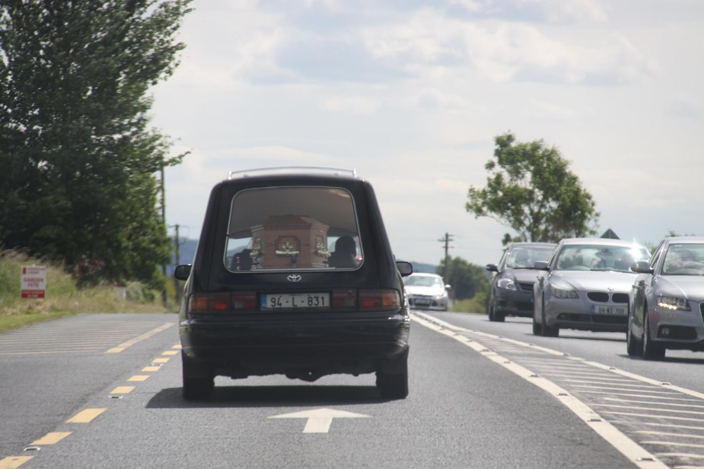 A Hearse in a Hurry, Overtaking Us at Some Great Speed