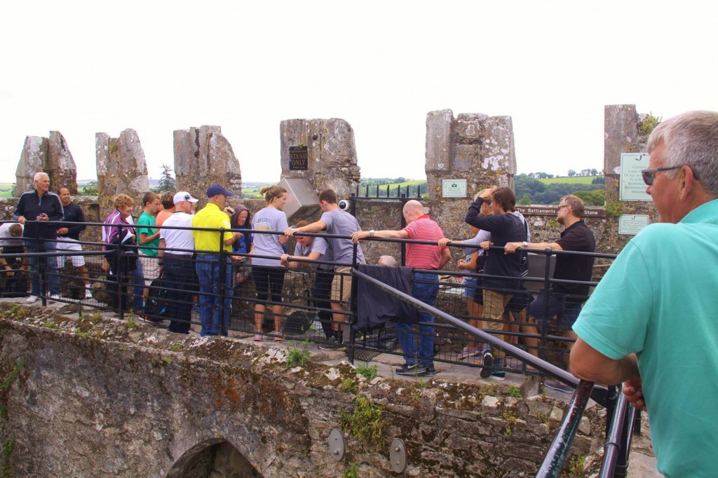A Crowd Lines Up to Kiss the Blarney Stone