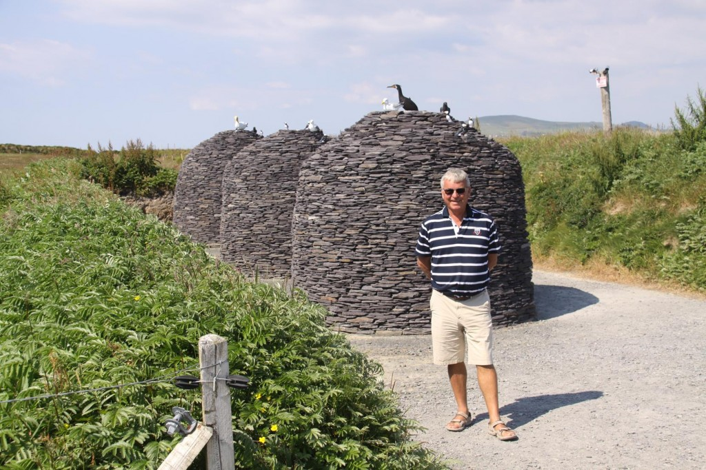 373 Ric Standing Infront of Examples of Beehive Huts which Date Back as Far as 2000BC