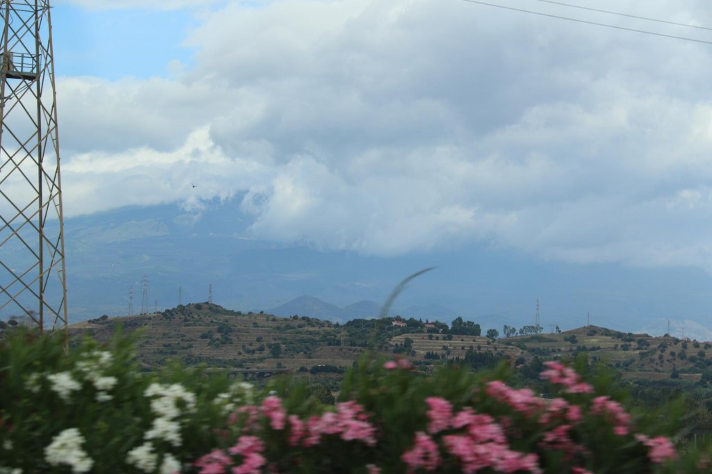 Mount Etna  appears to be covered with clouds too