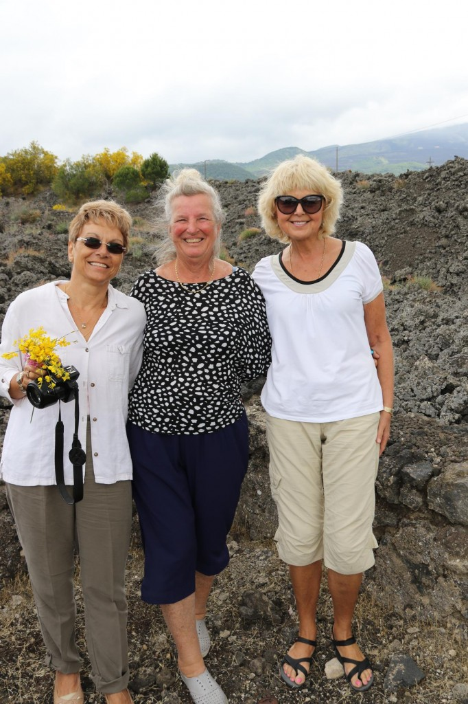 We stop to photograph the abundant clusters of heavily scented flowering bushes of Mt Etna Broom and in contrast  the endless hills of lava rock