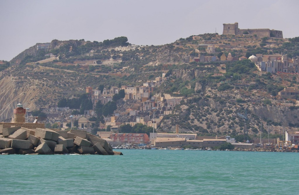 Arriving in the port of Licata,  the castle on the hill and the cemetery are quite conspicious