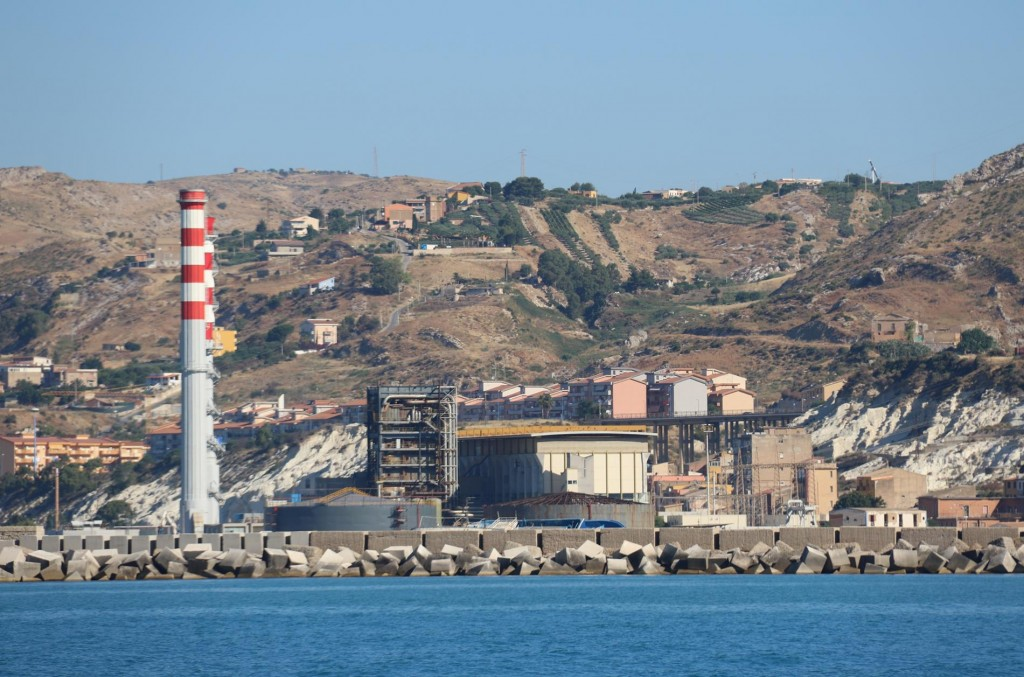 As we approach the port the 2 chimney stacks and the tall buildings in the town come into view