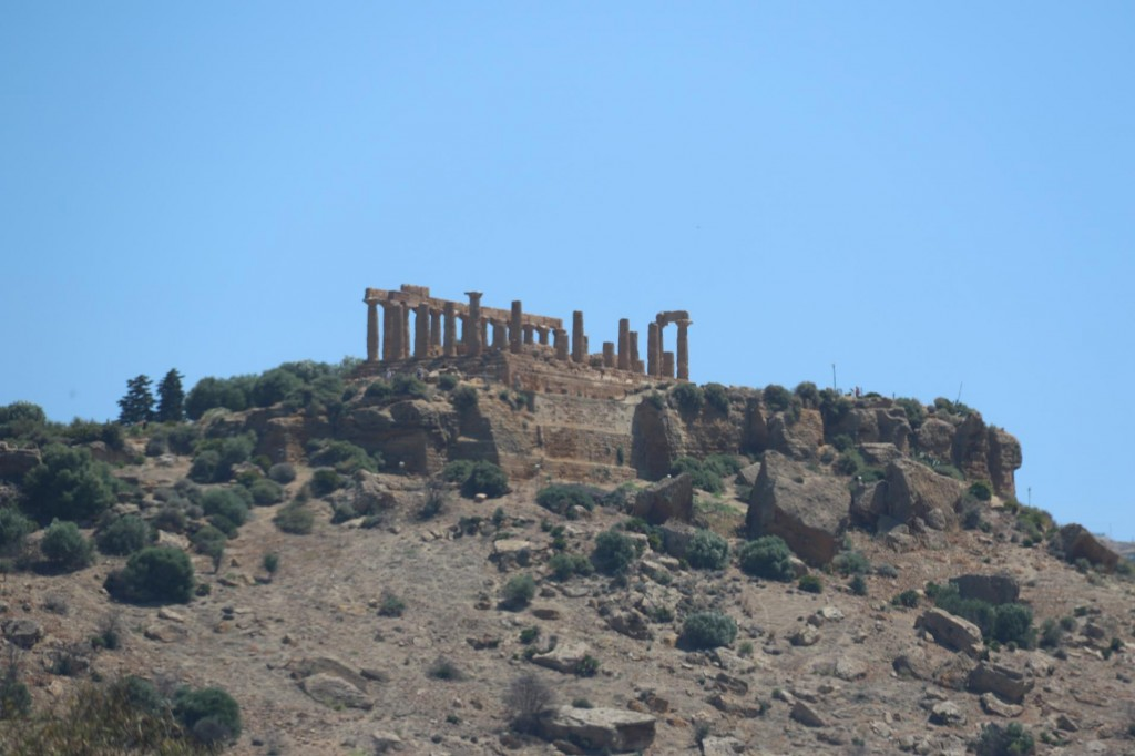 As we drive to the site the first of the temples come into view perched high on a ridge