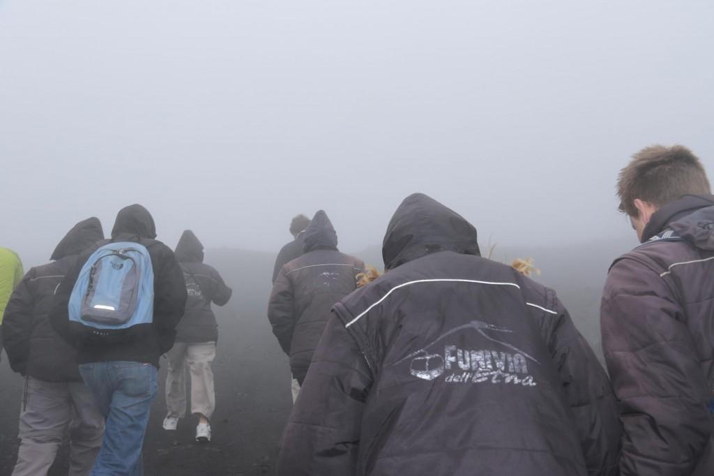 We shuffle off in groups, heads bowed avoiding the horizontal rain and sleet