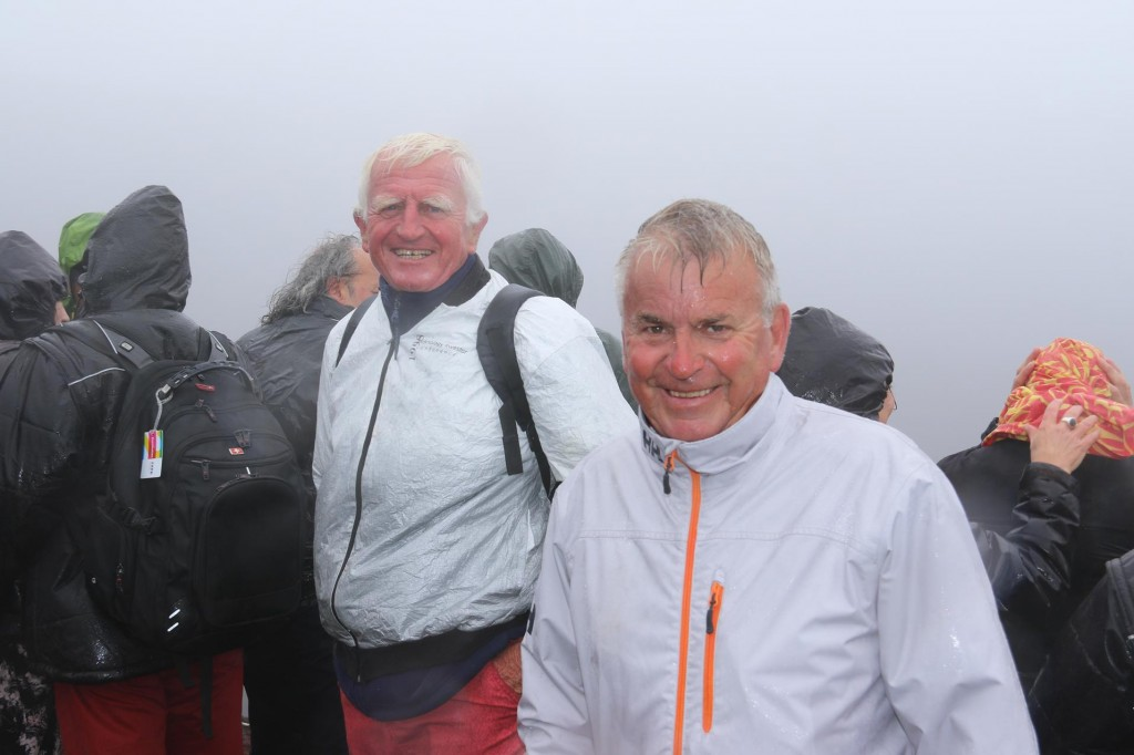 Ric and Roland both soaked to the skin and freezing cold in their shorts still managed a smile