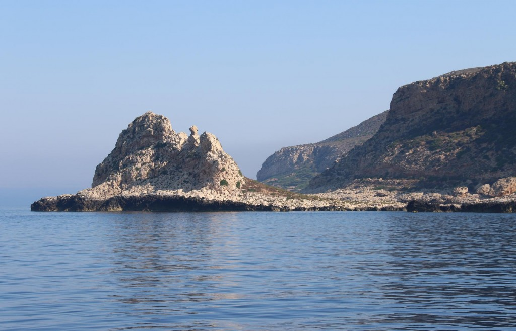 We pass Il Faraglione at the south western tipof the island