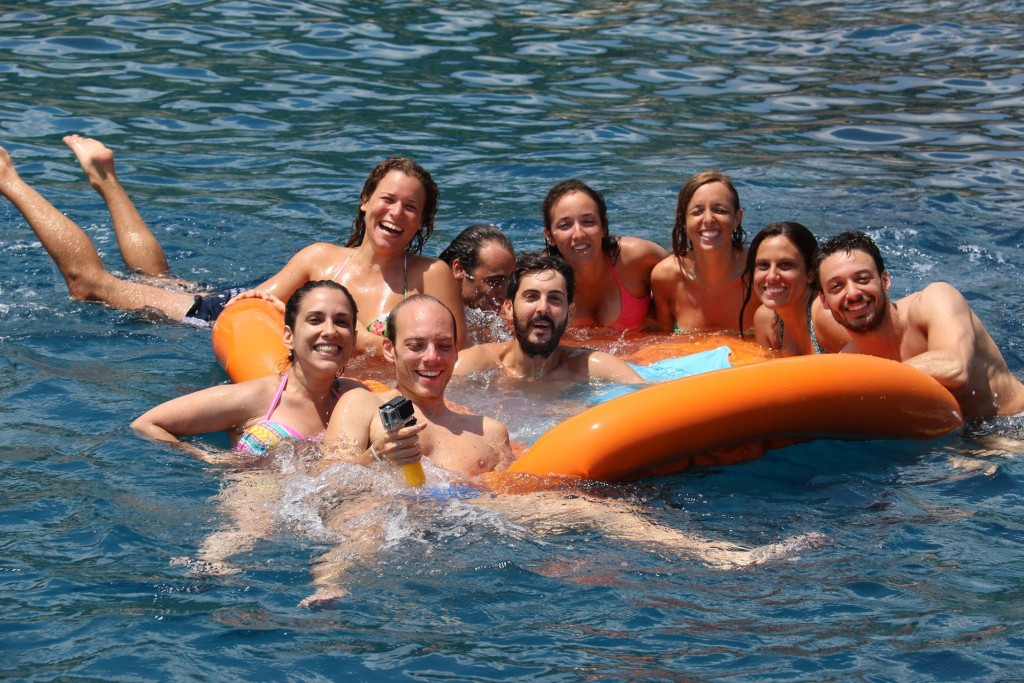 After borrowing our dinghy pump a group of young Sicilians pose for a photo in their floating water toy
