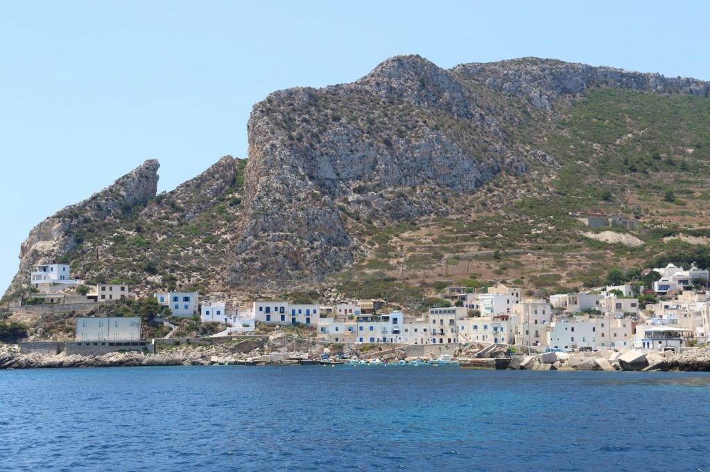 The quaint port of Cala Dogana comes into view
