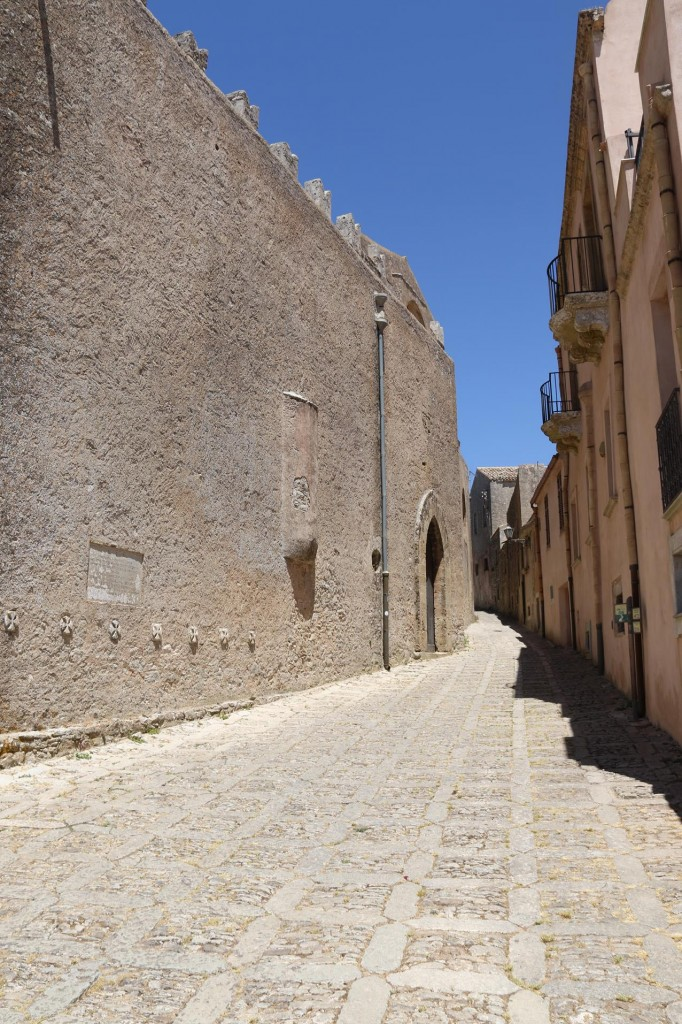 Well preserved neatly patterned cobblestone streets weave through the ancient town